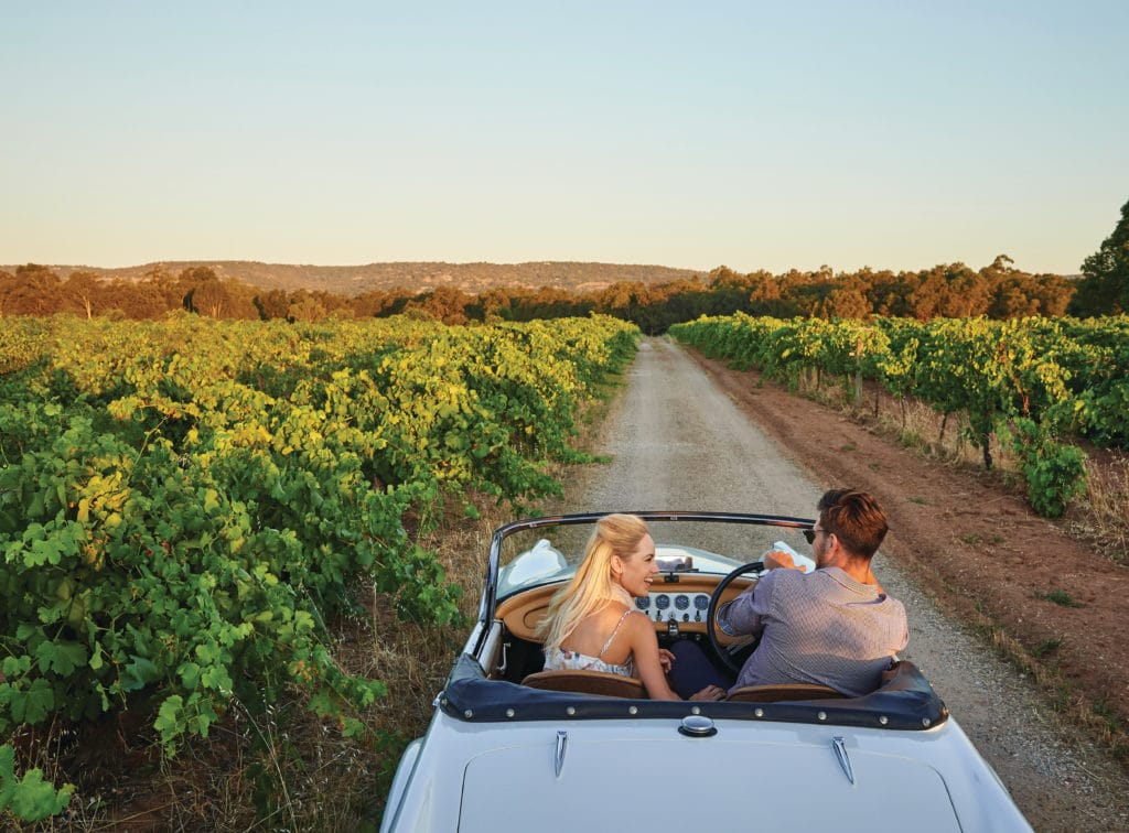 Couple Driving in the Swan Valley at sunset.