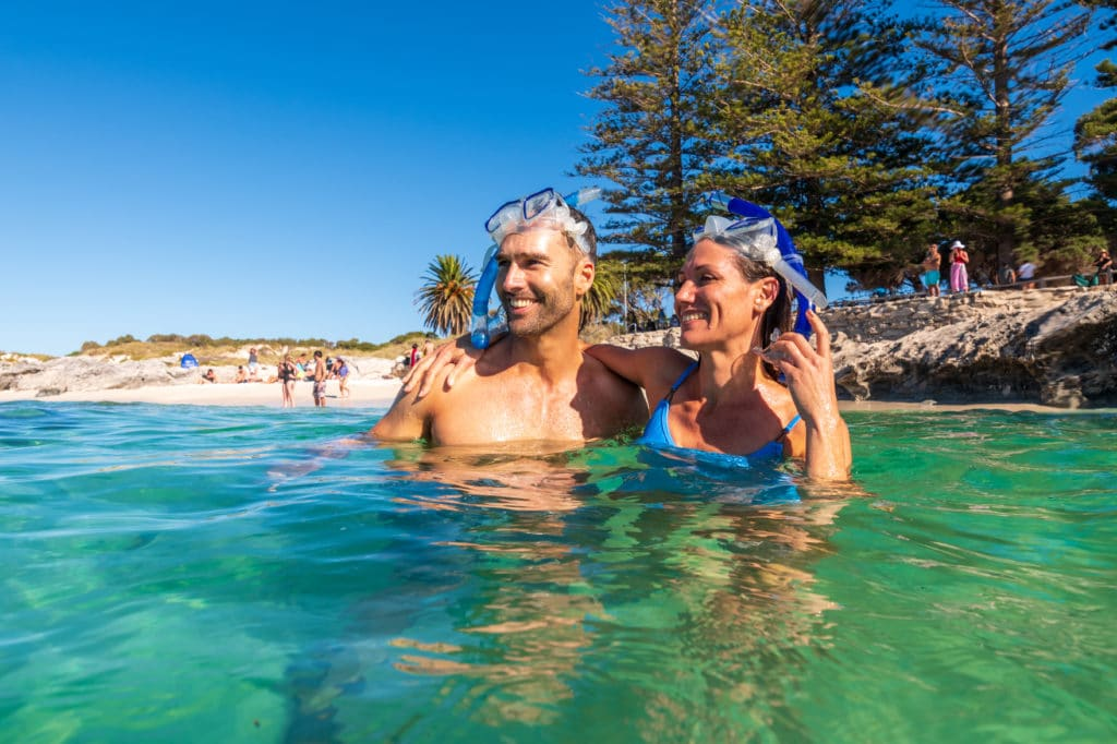 Couple standing up in the water at Rottnest Island