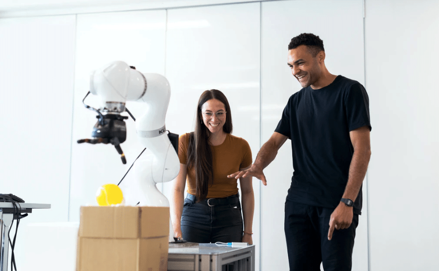 lady and man happy looking at white object