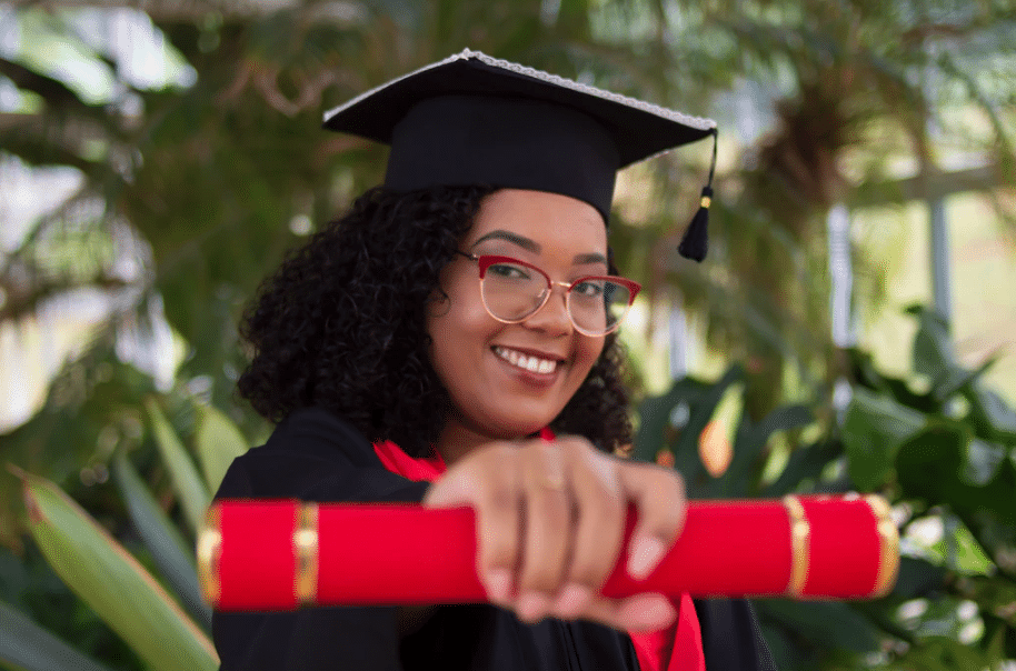 happy girl with red graduation scroll
